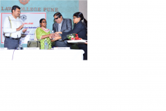 Dr. Sanjay Jain felicitating Ms. Beno Zephine